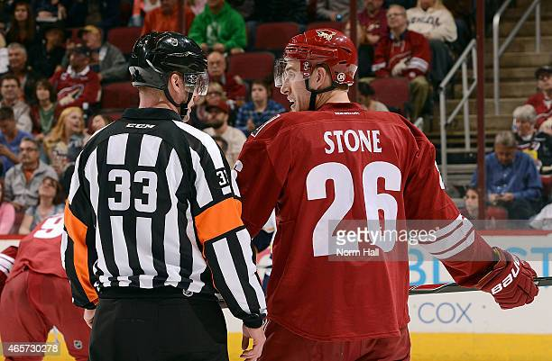 Michael Stone of the Arizona Coyotes talks with referee Kevin Pollock during second period action against the Nashville Predators at Gila River Arena...