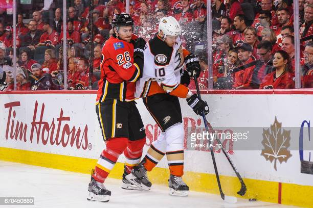 Michael Stone of the Calgary Flames checks Corey Perry of the Anaheim Ducks in Game Four of the Western Conference First Round during the 2017 NHL...