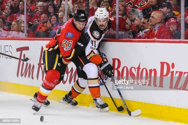 Michael Stone of the Calgary Flames checks Logan Shaw of the Anaheim Ducks in Game Three of the Western Conference First Round during the 2017 NHL...