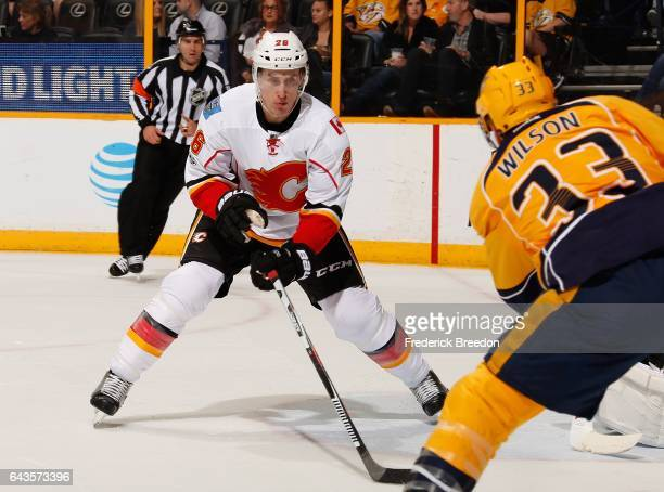 Michael Stone of the Calgary Flames plays against Colin Wilson of the Nashville Predators during the first period at Bridgestone Arena on February 21...