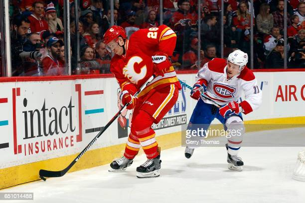 Michael Stone of the Calgary Flames skates against Brendan Gallagher of the Montreal Canadiens during an NHL game on March 9 2017 at the Scotiabank...
