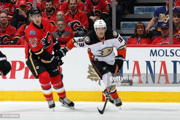 Michael Stone of the Calgary Flames skates against Jakob Silfverberg of the Anaheim Ducks during Game Four of the Western Conference First Round...