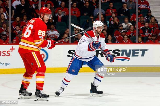 Michael Stone of the Calgary Flames skates against Torrey Mitchell of the Montreal Canadiens during an NHL game on March 9 2017 at the Scotiabank...