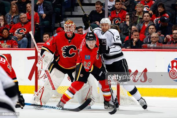 Michael Stone of the Calgary Flames skates against Trevor Lewis of the Los Angeles Kings during an NHL game on February 28 2017 at the Scotiabank...