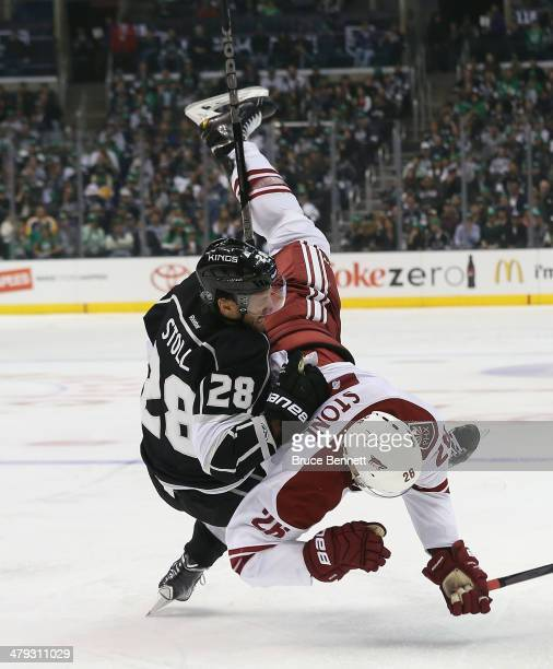 Michael Stone of the Phoenix Coyotes and Jarret Stoll of the Los Angeles Kings get tangled up during the second period at the Staples Center on March...