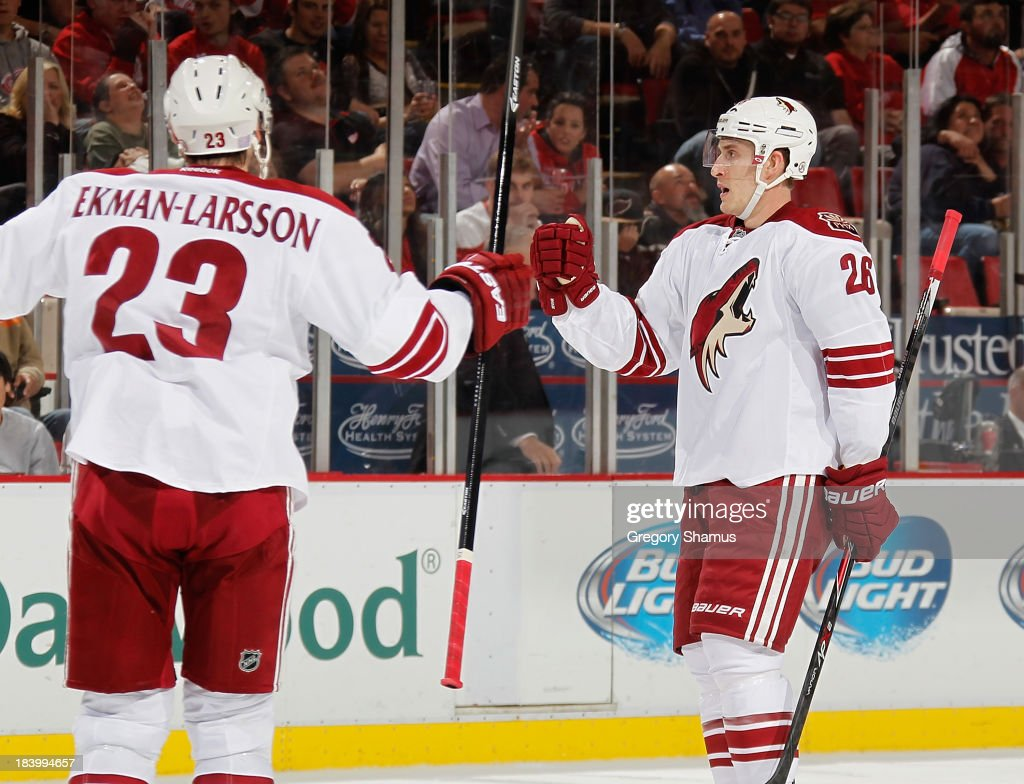 Michael Stone #26 of the Phoenix Coyotes celebrates his third period goal with <a gi-track='captionPersonalityLinkClicked' href=/galleries/search?phrase=Oliver+Ekman-Larsson&family=editorial&specificpeople=5894618 ng-click='$event.stopPropagation()'>Oliver Ekman-Larsson</a> #23 while playing the Detroit Red Wings at Joe Louis Arena on October 10, 2013 in Detroit, Michigan. Phoenix won the game 4-2.