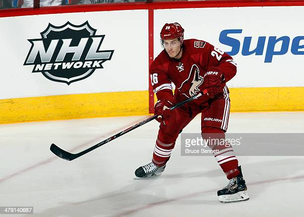 Michael Stone of the Phoenix Coyotes skates against the Calgary Flames at the Jobingcom Arena on March 15 2014 in Glendale Arizona The Coyotes...