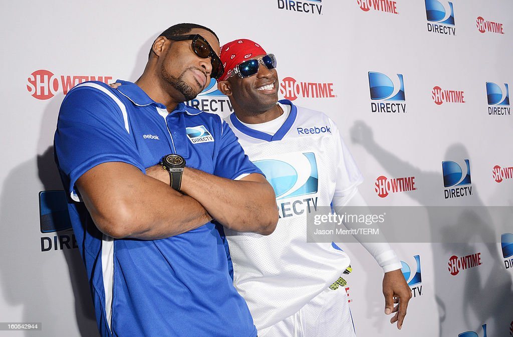 Michael Strahan and Deion Sanders attend DIRECTV'S Seventh Annual Celebrity Beach Bowl at DTV SuperFan Stadium at Mardi Gras World on February 2, 2013 in New Orleans, Louisiana.