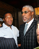 Michael Strahan and Julius Erving during Michael Strahan and New York Law Firm Dreier LLP Hold a Chartiy Event with Jon Bon Jovi at Tao July 9 2006...