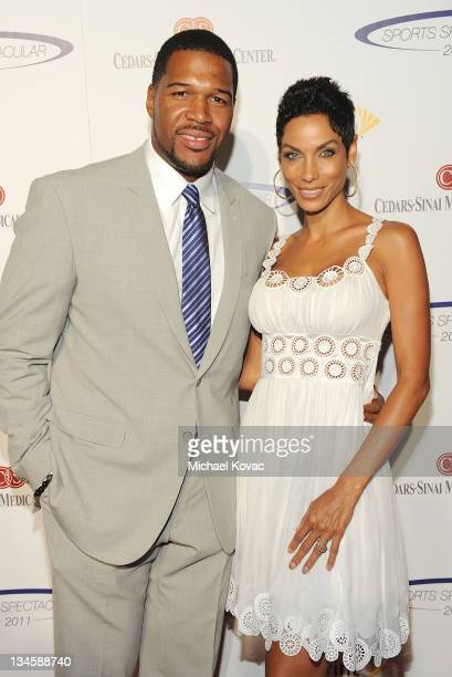 Michael Strahan and Nicole Murphy arrive at the 26th Anniversary Sports Spectacular at the Hyatt Regency Century Plaza on May 22 2011 in Century City...