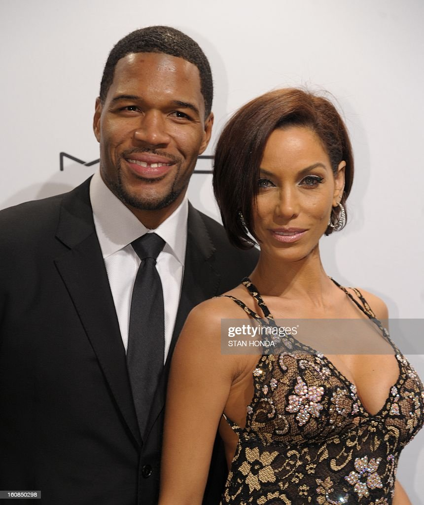Michael Strahan (L) and Nicole Murphy (R) arrive at the amfAR (The Foundation for AIDS Research) gala that kicks off the Mercedes-Benz Fashion Week February 6, 2013 in New York. AFP PHOTO/Stan HONDA
