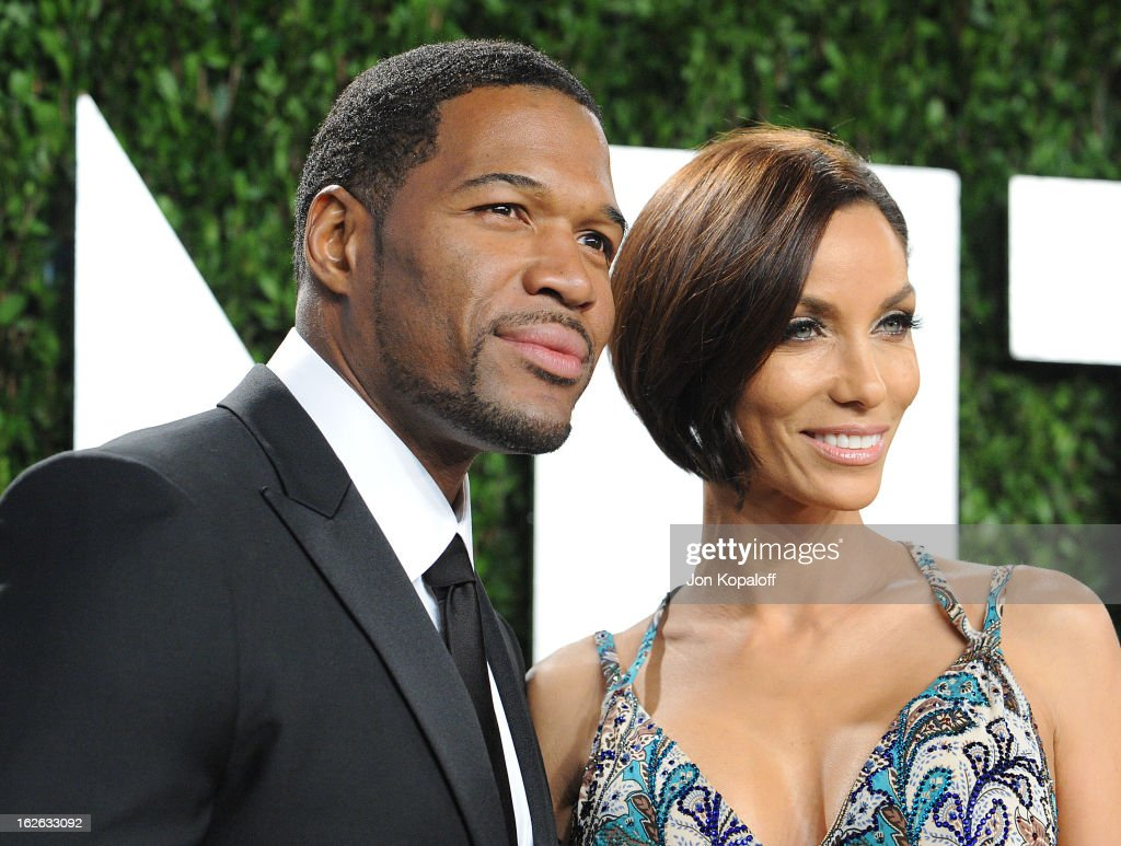 Michael Strahan and Nicole Murphy attend the 2013 Vanity Fair Oscar party at Sunset Tower on February 24, 2013 in West Hollywood, California.