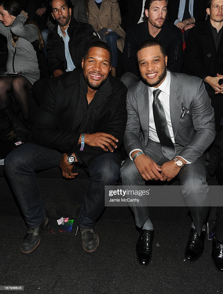 <a gi-track='captionPersonalityLinkClicked' href=/galleries/search?phrase=Michael+Strahan&family=editorial&specificpeople=210563 ng-click='$event.stopPropagation()'>Michael Strahan</a> and <a gi-track='captionPersonalityLinkClicked' href=/galleries/search?phrase=Robinson+Cano&family=editorial&specificpeople=538362 ng-click='$event.stopPropagation()'>Robinson Cano</a> attends the 2013 Victoria's Secret Fashion Show at Lexington Avenue Armory on November 13, 2013 in New York City.