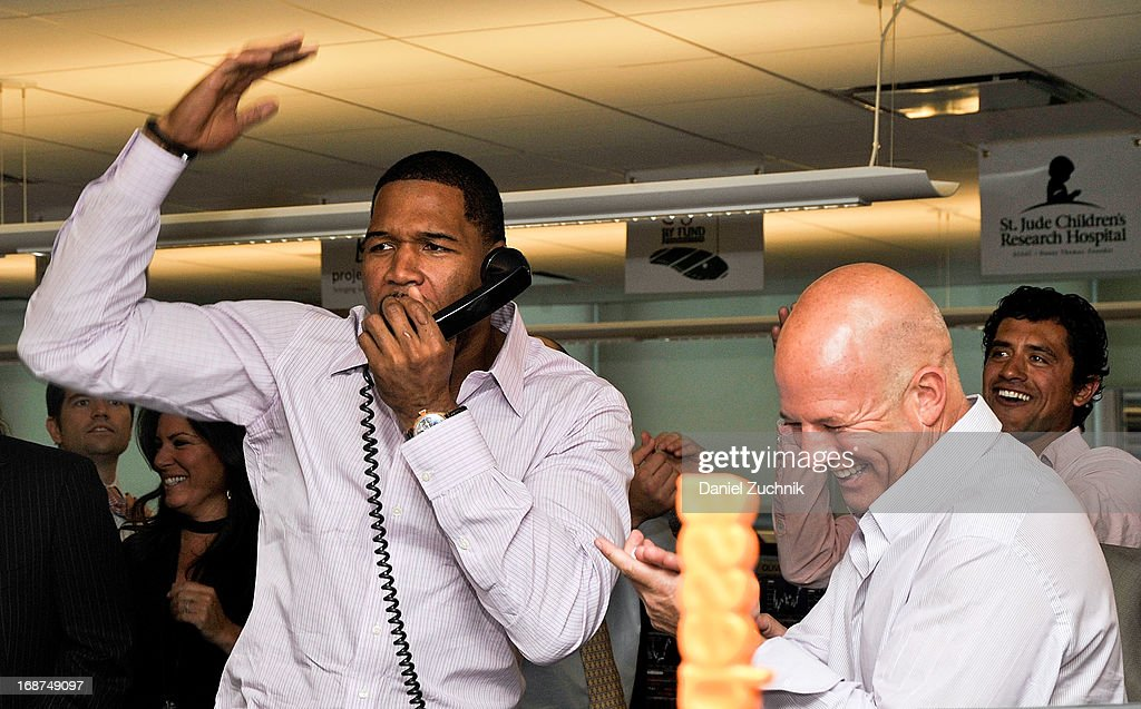 <a gi-track='captionPersonalityLinkClicked' href=/galleries/search?phrase=Michael+Strahan&family=editorial&specificpeople=210563 ng-click='$event.stopPropagation()'>Michael Strahan</a> and Steven Starker attend the 2013 Commissions For Charity Day at BTIG on May 14, 2013 in New York City.