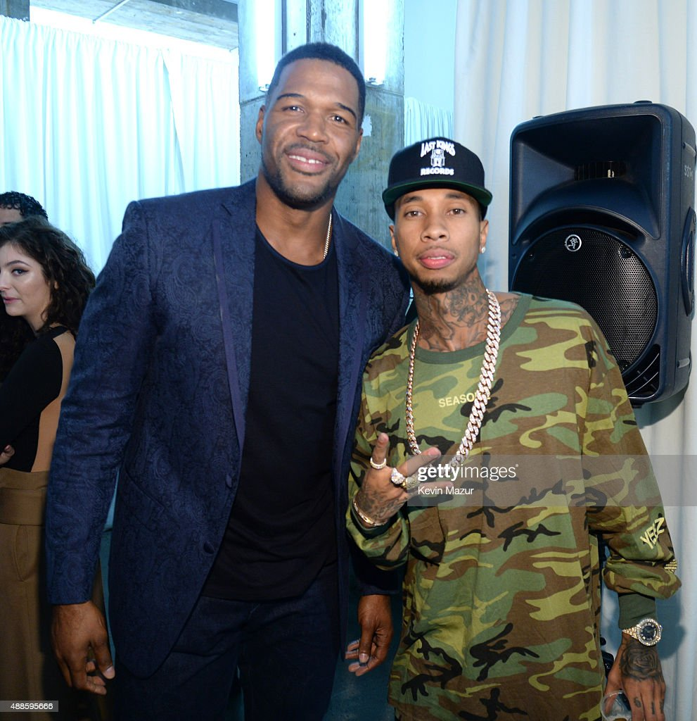 Michael Strahan and Tyga attend Kanye West Yeezy Season 2 during New York Fashion Week at Skylight Modern on September 16, 2015 in New York City.