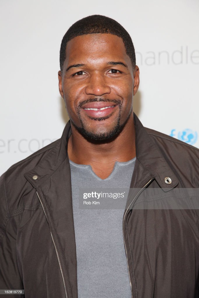 <a gi-track='captionPersonalityLinkClicked' href=/galleries/search?phrase=Michael+Strahan&family=editorial&specificpeople=210563 ng-click='$event.stopPropagation()'>Michael Strahan</a> attends the 'A Year In A New York Minute' photo exhibition opening at Canoe Studios on September 26, 2012 in New York City.
