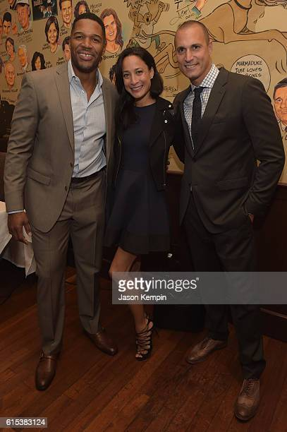 Michael Strahan Cristen Barker and Nigel Barker attends the New York Fatherhood Lunch to benefit GOOD Foundation on October 18 2016 in New York City