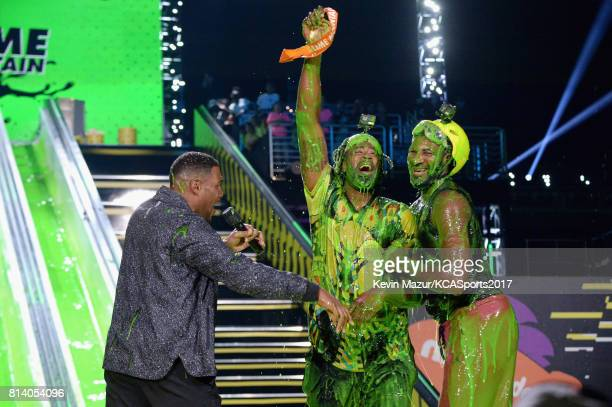 Michael Strahan NBA player DeAndre Jordan and NBA player Andre Drummond speak onstage during a competition at Nickelodeon Kids' Choice Sports Awards...