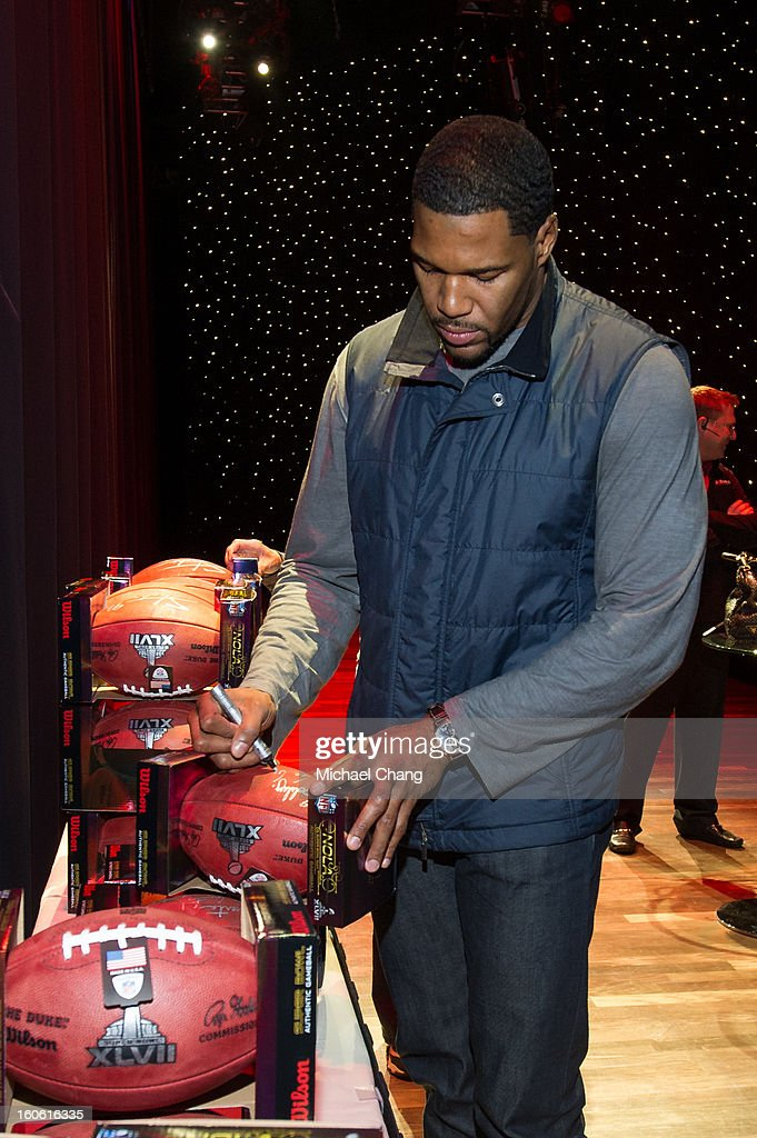 <a gi-track='captionPersonalityLinkClicked' href=/galleries/search?phrase=Michael+Strahan&family=editorial&specificpeople=210563 ng-click='$event.stopPropagation()'>Michael Strahan</a> signs footballs before the Ultimate Super Bowl Tailgate Party hosted by <a gi-track='captionPersonalityLinkClicked' href=/galleries/search?phrase=Michael+Strahan&family=editorial&specificpeople=210563 ng-click='$event.stopPropagation()'>Michael Strahan</a> at Harrah's Casino on February 3, 2013 in New Orleans, Louisiana.