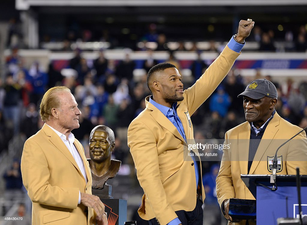 FOOTBALL - 11/3/14 - Michael Strahan was celebrated at Met Life Stadium as he received his Pro Football Hall of Fame ring. The 2014 inductee was joined by fellow Giants Hall of Famers Frank Gifford, Harry Carson and Lawrence Taylor in a ceremony at halftime of the Giants game against the Indianapolis Colts. (Photo by Ida Mae Astute/ABC via Getty Images) FRANK