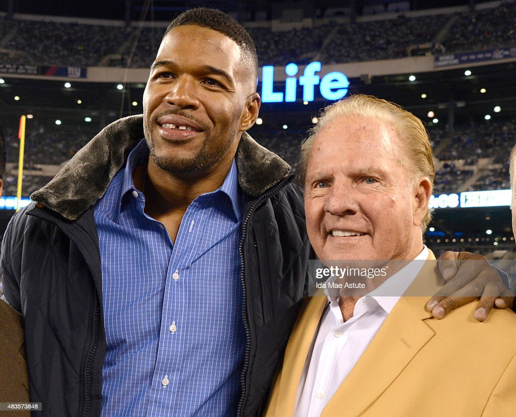 FOOTBALL - 11/3/14 - Michael Strahan was celebrated at Met Life Stadium as he received his Pro Football Hall of Fame ring. The 2014 inductee was joined by fellow Giants Hall of Famers Frank Gifford, Harry Carson and Lawrence Taylor in a ceremony at halftime of the Giants game against the Indianapolis Colts.