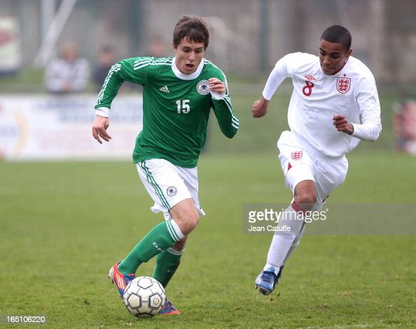 Michael Strein of Germany and Max Lowe of England in action during the Tournament of Montaigu qualifier match between U16 Germany and U16 England at...