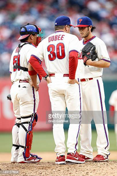 Michael Stutes of the Philadelphia Phillies meets with pitching coach Rich Dubee and Carlos Ruiz on the mound during the game against the New York...