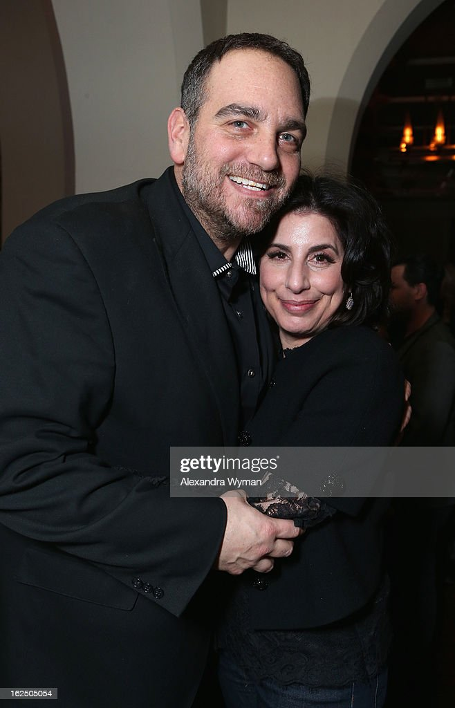 Michael Sugar (L) and Sue Kroll of Warner Bros. attend GREY GOOSE Pre-Oscar Party hosted by Michael Sugar, Doug Wald, Nathan Kahane and Warren Zavala at Chateau Marmont on February 23, 2013 in Los Angeles, California.