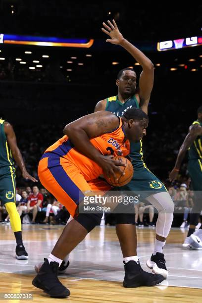 Michael Sweetney of 3's Company handles the ball against Dominic McGuire of the Ball Hogs during week one of the BIG3 three on three basketball...
