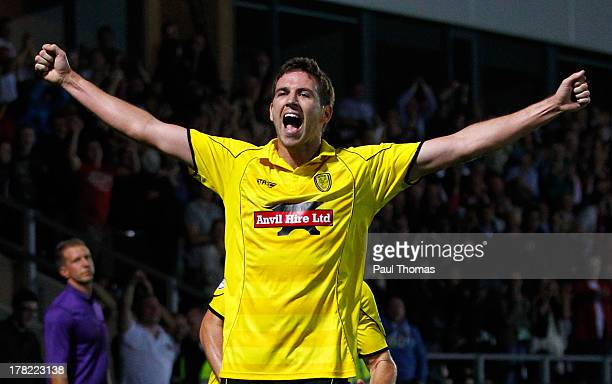 Michael Symes of Burton Albion celebrates after scoring their second goal during the Capital One Cup Second Round match between Burton Albion and...