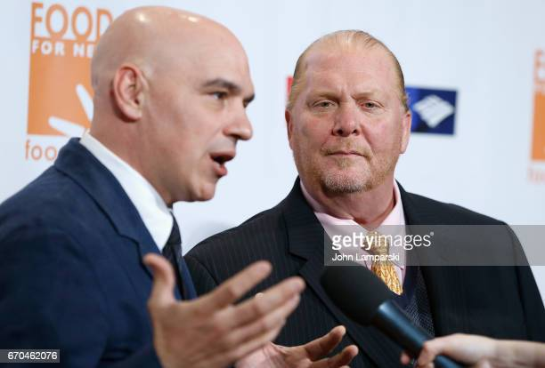 Michael Symon and Mario Batali attend 2017 CanDo Awards at Cipriani Wall Street on April 19 2017 in New York City
