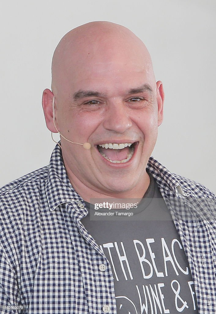 Michael Symon attends South Beach Wine and Food Festival 2013 Grand Tasting Village on February 24, 2013 in Miami Beach, Florida.