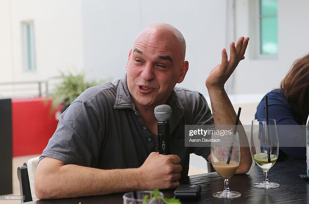 Michael Symon attends What It Takes To Be An Iron Chef at Hotel Victor on February 22, 2013 in Miami Beach, Florida.
