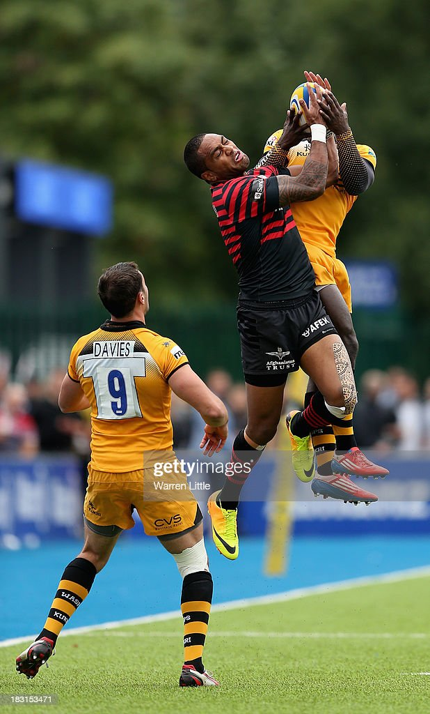 Michael Tagicakibau of Saracens jumps against Christian Wade of London Wasps during the Aviva Premiership match between Saracens and London Wasps at Allianz Park on October 5, 2013 in Barnet, England.