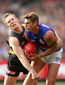 Michael Talia of the Bulldogs marks infront of Jack Riewoldt of the Tigers during the round two AFL match between the Richmond Tigers and the Western...