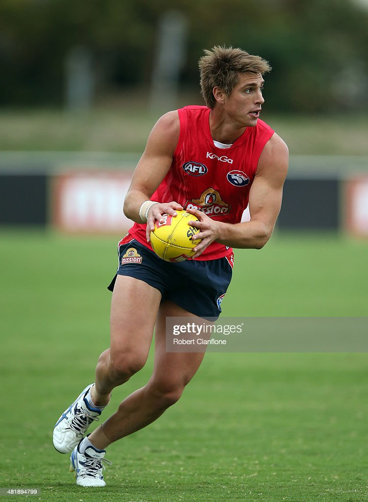 Michael Talia of the Bulldogs runs with the ball during a Western Bulldogs AFL training session at Whitten Oval on April 2, 2014 in Melbourne, Australia.
