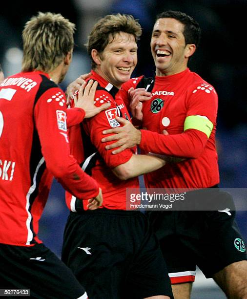 Michael Tarnat celebrates scoring the second goal with Altin Lala and Christoph Dabrowski of Hanover during the Bundesliga match between Hanover 96...