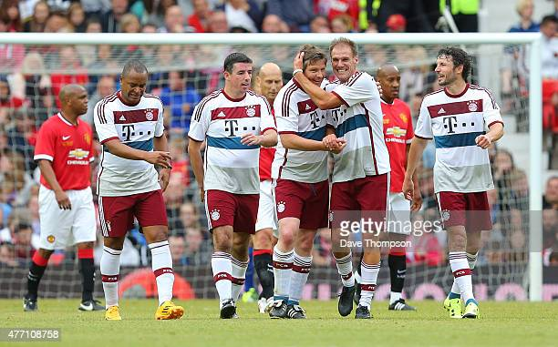 Michael Tarnat of Bayern Munich All Stars celebrates scoring his sides second goal during the Manchester United Foundation charity match between...