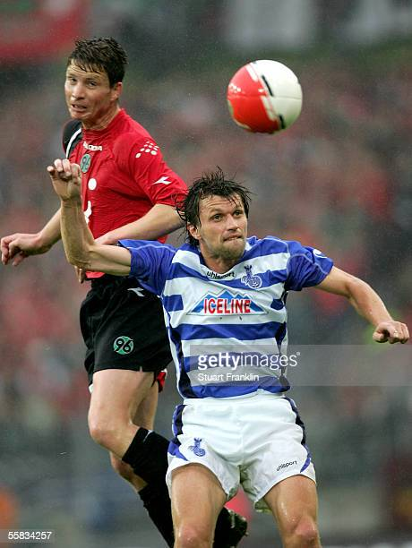 Michael Tarnat of Hannover challenges Cartsen Wolters of Duisburg during the Bundesliga match between Hannover 96 and MSV Duisburg at the AWD Arena...