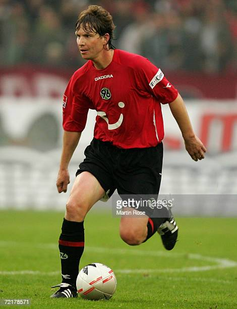 Michael Tarnat of Hannover runs with the ball during the Bundesliga match between Hanover 96 and Eintracht Frankfurt at the AWD Arena on October 14...