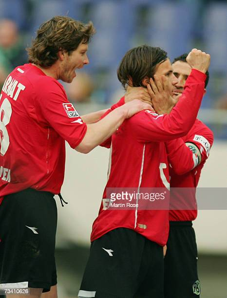 Michael Tarnat Szablocs Huszti and Altin Lala of Hanover celebrate the 1st goal during the Bundesliga match between Hanover 96 and Borussia Dortmund...