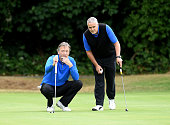 Michael Taylor and Jon Short of Shirley Park Golf Club line up a putt on the 1st green during the The Lombard Trophy South Qualifier at Walton Heath...