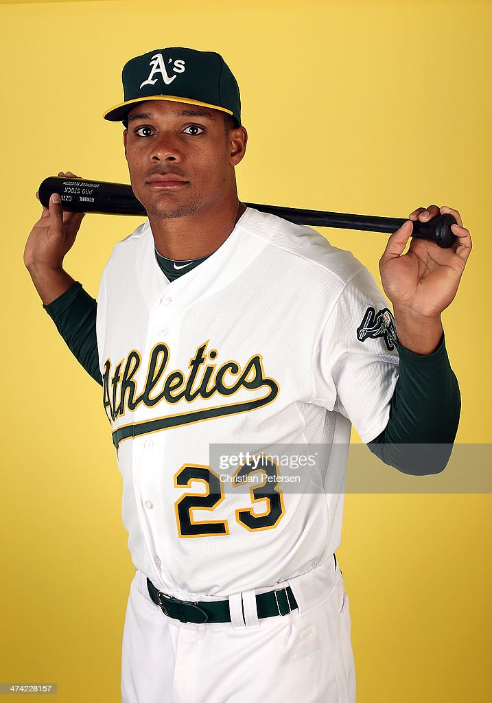 Michael Taylor #23 of the Oakland Athletics poses for a portrait during the spring training photo day at Phoenix Municipal Stadium on February 22, 2014 in Phoenix, Arizona.