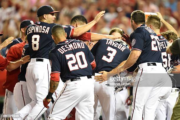 Michael Taylor of the Washington Nationals celebrates a walk off three run home run in the 10th inning during a baseball game against the Atlanta...