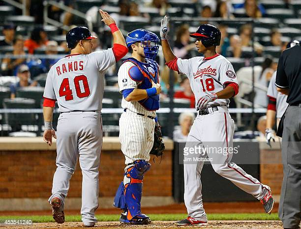 Michael Taylor of the Washington Nationals celebrates his sixth inning two run home run against the New York Mets with teammate Wilson Ramos at Citi...
