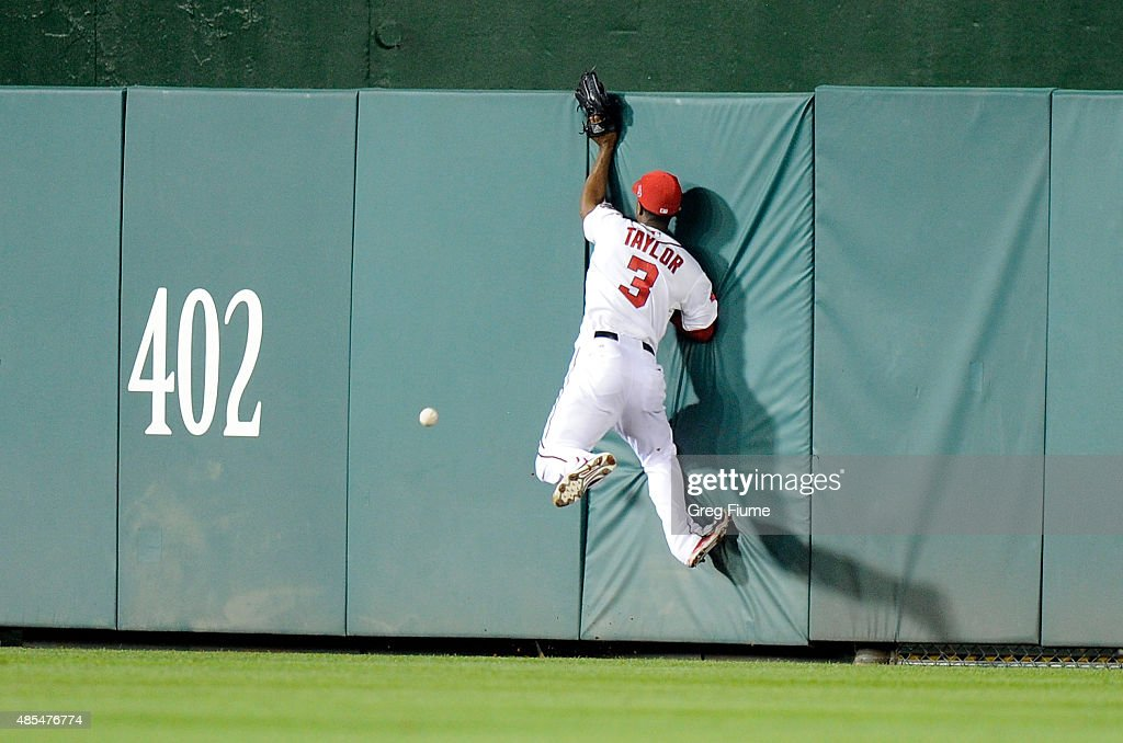 Michael Taylor #3 of the Washington Nationals crashes into the wall trying to catch a triple in the seventh inning by Melvin Upton Jr. #2 (not pictured) of the San Diego Padres at Nationals Park on August 27, 2015 in Washington, DC.