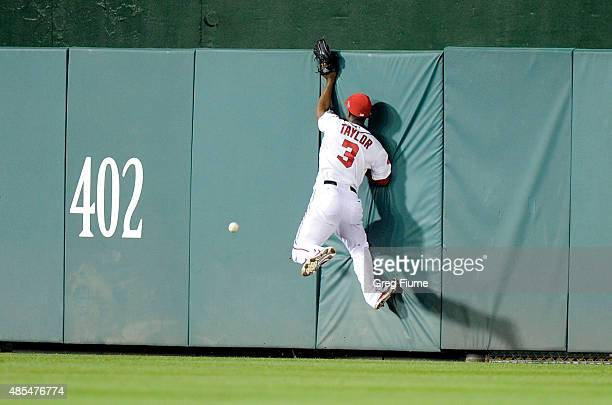 Michael Taylor of the Washington Nationals crashes into the wall trying to catch a triple in the seventh inning by Melvin Upton Jr #2 of the San...