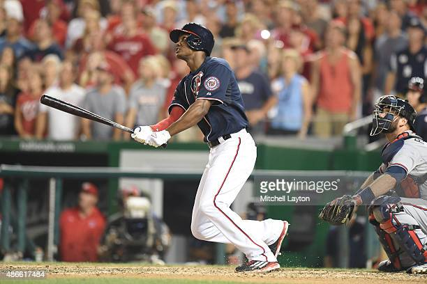 Michael Taylor of the Washington Nationals hits a walk off three run home run in the 10th inning during a baseball game against the Atlanta Braves at...