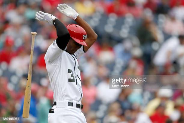 Michael Taylor of the Washington Nationals reacts after striking out for the third out of the seventh inning against the San Diego Padres at...