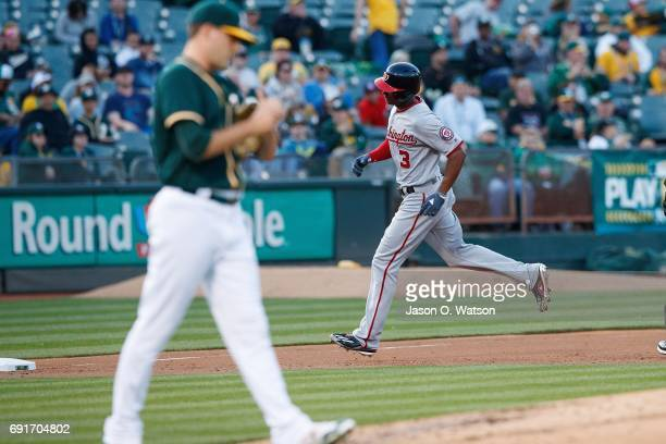 Michael Taylor of the Washington Nationals rounds the bases after hitting a home run off of Andrew Triggs of the Oakland Athletics during the second...